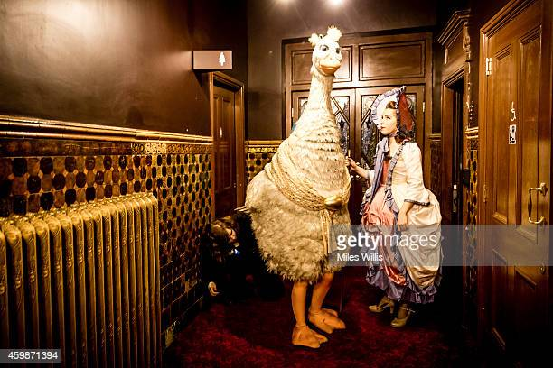 Alix Ross playing Pricilla The Goose waits to enter the auditorium during a performance of Mother Goose at Hackney Empire on December 2 2014 in...
