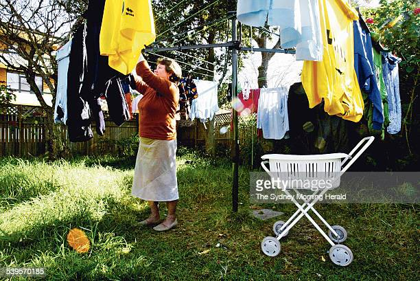 Alix Sowden hangs out the second of three washing loads for her family of eight children on the clothes line at her Summer Hill home 17 June 2005 SMH...