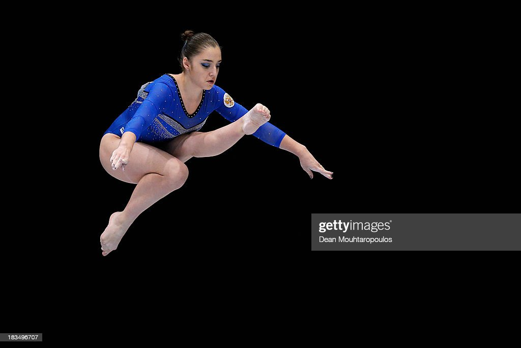 Aliya Mustafina of Russia competes on her way to winning the Gold medal in the Women's balance beam final on Day Seven of the Artistic Gymnastics World Championships Belgium 2013 held at the Antwerp Sports Palace on October 6, 2013 in Antwerpen, Belgium.