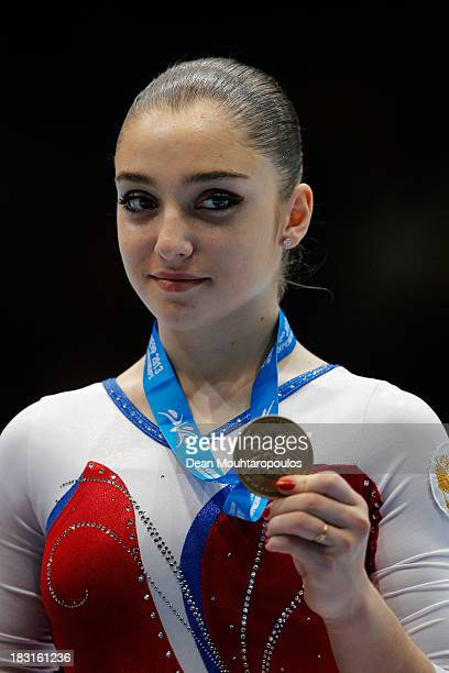 Aliya Mustafina of Russia poses after winning the bronze medal in the Uneven Bars Final on Day Six of the Artistic Gymnastics World Championships...
