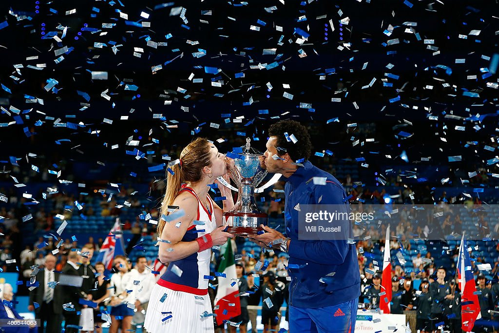 Alize Cornet and Jo-Wilfried Tsonga of France hold the Hopman Cup after defeating Grzegorz Panfil and Agnieszka Radwanska of Poland in the mixed doubles finals match during day eight of the Hopman Cup at Perth Arena on January 4, 2014 in Perth, Australia.