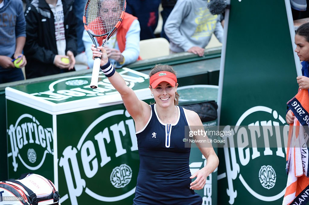 Alize Cornet celebrates during the Women's Singles first round on day three of the French Open 2016 at Roland Garros on May 24, 2016 in Paris, France.