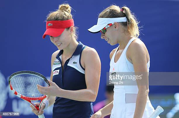 Alize Cornet of France and Magda Linette of Poland react against ChiaJung Chuang of Chinese Taipei and Chen Liang of China in the doubles final on...