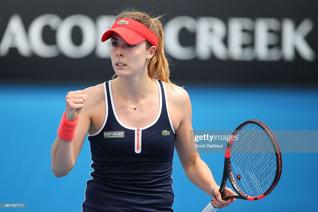 Alize Cornet of France celebrates a point in her first round match against Shuai Zhang of China during day two of the 2015 Australian Open at Melbourne Park on January 20, 2015 in Melbourne, Australia.