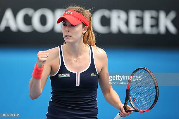 Alize Cornet of France celebrates a point in her first round match against Shuai Zhang of China during day two of the 2015 Australian Open at...