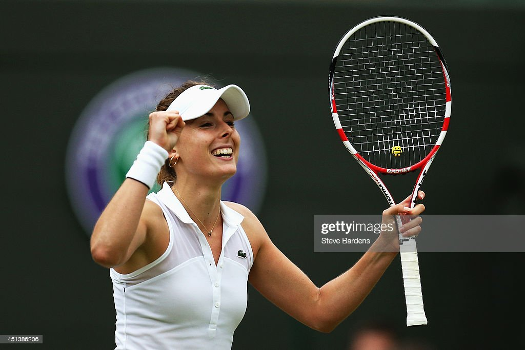 Alize Cornet of France celebrates after winning her Ladies' Singles third round match against Serena Williams of the United States on day six of the Wimbledon Lawn Tennis Championships at the All England Lawn Tennis and Croquet Club at Wimbledon on June 28, 2014 in London, England.