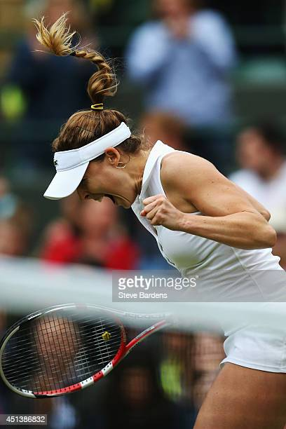 Alize Cornet of France celebrates after winning her Ladies' Singles third round match against Serena Williams of the United States on day six of the...