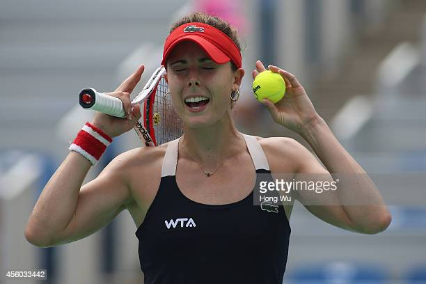 Alize Cornet of France celebrates after winning her match against Kirsten Flipkens of Belgium during day four of the 2014 Dongfeng Motor Wuhan Open...