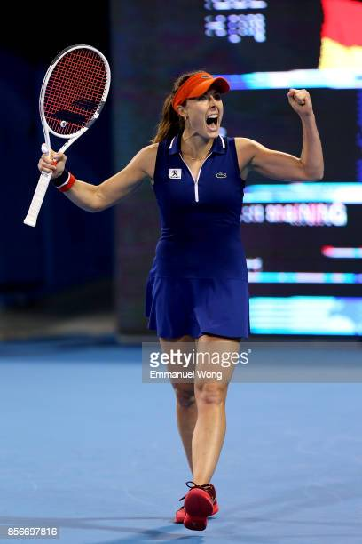 Alize Cornet of France celebrates after winning the match against Angelique Kerber of Germany on day three of the 2017 China Open at the China...