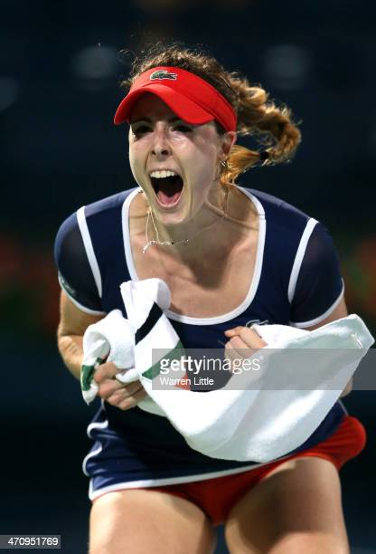 Alize Cornet of France celebrates beating Serena Williams of the USA during the semi finals of the WTA Dubai Duty Free Tennis Championship at the...