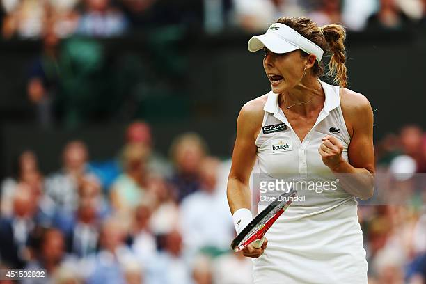 Alize Cornet of France celebrates during her Ladies' Singles fourth round match against Eugenie Bouchard of Canada on day seven of the Wimbledon Lawn...