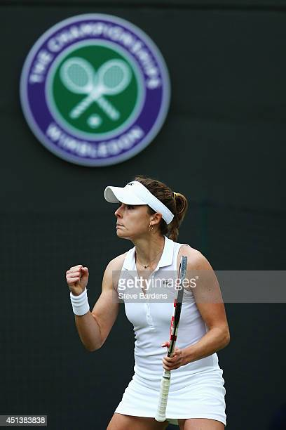 Alize Cornet of France celebrates during her Ladies' Singles third round match against Serena Williams of the United States on day six of the...