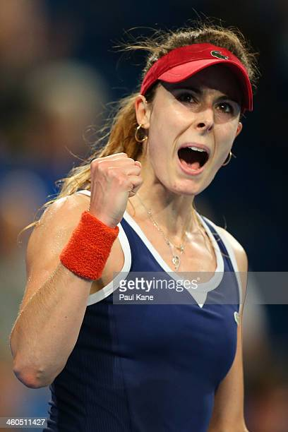 Alize Cornet of France celebrates winning a game against Agnieszka Radwanska of Poland in the women's singles final during day eight of the Hopman...