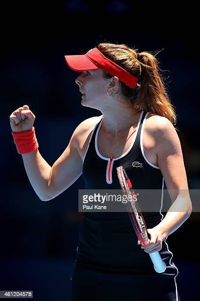 Alize Cornet of France celebrates winning a game in her singles match against Agnieszka Radwanska of Poland during day six of the 2015 Hopman Cup at...