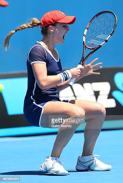 Alize Cornet of France celebrates winning her second round match against Camila Giorgi of Italy during day four of the 2014 Australian Open at...