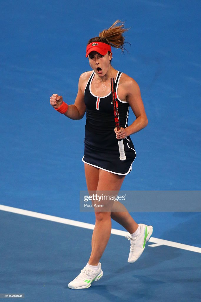 Alize Cornet of France celebrates winning her singles match against Heather Watson of Great Britain during day two of the 2015 Hopman Cup at Perth Arena on January 5, 2015 in Perth, Australia.
