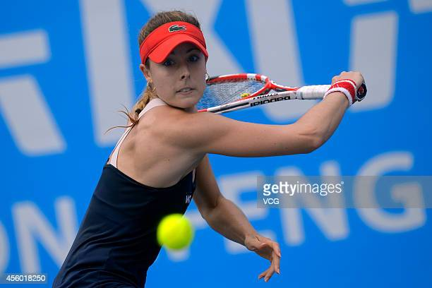 Alize Cornet of France competes with Kirsten FLIPKENS of Belgium during day four of the 2014 Dongfeng Motor Wuhan Open at Optics Valley International...