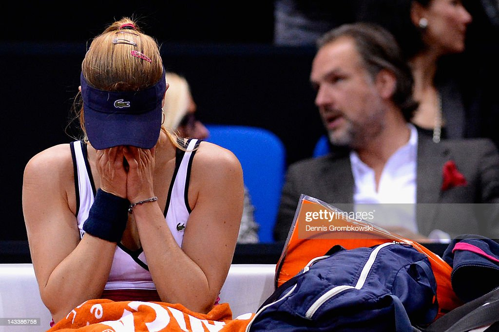 Alize Cornet of France cries after being injured in her match against Maria Sharapova of Russia during day three of the WTA Porsche Tennis Grand Prix at Porsche Arena on April 25, 2012 in Stuttgart, Germany.