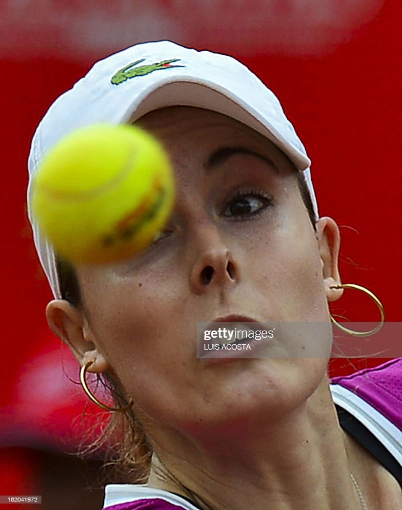Alize Cornet of France eyes the ball to return it to Elina Svitolina of Ukraine, during the WTA Bogota Open tennis Championship, on February 18, 2013. AFP PHOTO/Luis Acosta