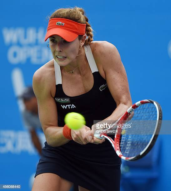 Alize Cornet of France hits a return during her quarterfinal match against Eugenie Bouchard of Canada at the Wuhan Open tennis tournament in Wuhan in...