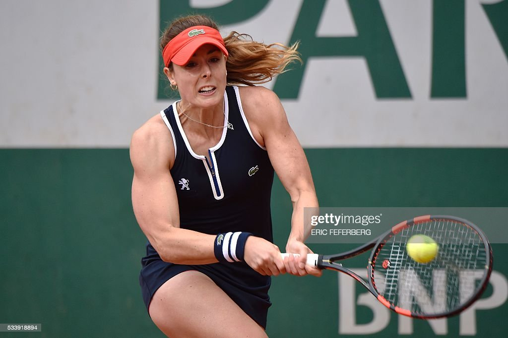 Alize Cornet of France hits a return to Kirsten Flipkens of Belgium during their women's first round match at the Roland Garros 2016 French Tennis Open in Paris on May 24, 2016. / AFP / Eric FEFERBERG