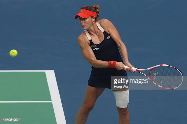 Alize Cornet of France in action during her match against Eugenie Bouchard of Canada on day five of the 2014 Dongfeng Motor Wuhan Open at Optics...