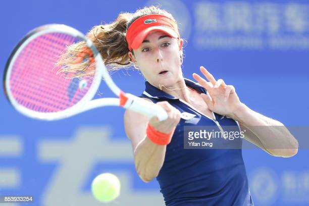 Alize Cornet of France plays a backhand during the second round Ladies Singles match against Svetlana Kuznetsova of Russia on Day 3 of 2017 Dongfeng...