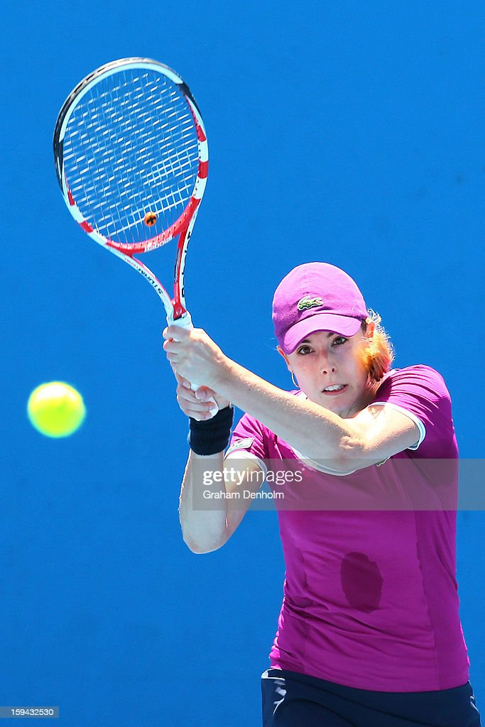 Alize Cornet of France plays a backhand in her first round match against Marina Erakovic of New Zealand during day one of the 2013 Australian Open at Melbourne Park on January 14, 2013 in Melbourne, Australia.
