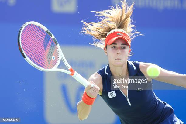 Alize Cornet of France plays a forehand during the second round Ladies Singles match against Svetlana Kuznetsova of Russia on Day 3 of 2017 Dongfeng...