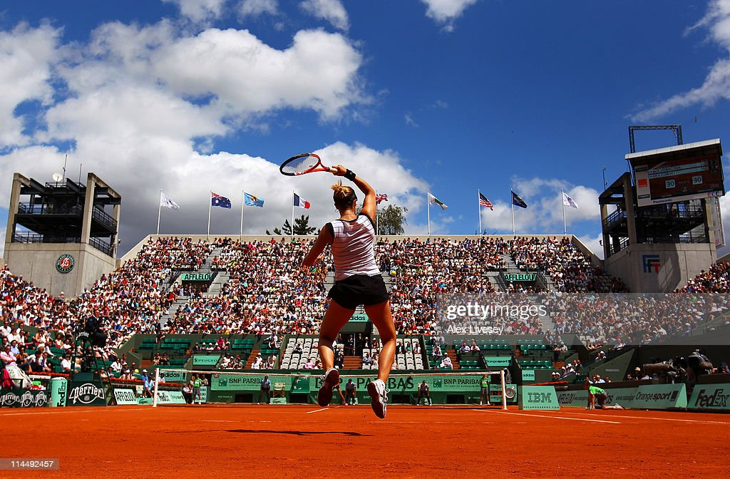 Alize Cornet of France plays a forehand during the women's singles round one match between Renata Voracova of Czech Republic and Alize Cornet of France day one of the French Open at Roland Garros on May 22, 2011 in Paris, France.