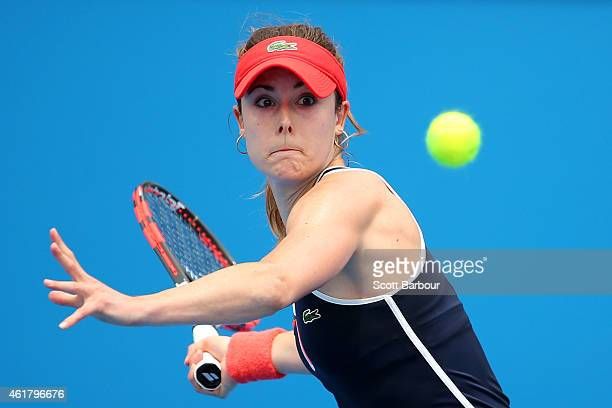 Alize Cornet of France plays a forehand in her first round match against Shuai Zhang of China during day two of the 2015 Australian Open at Melbourne...