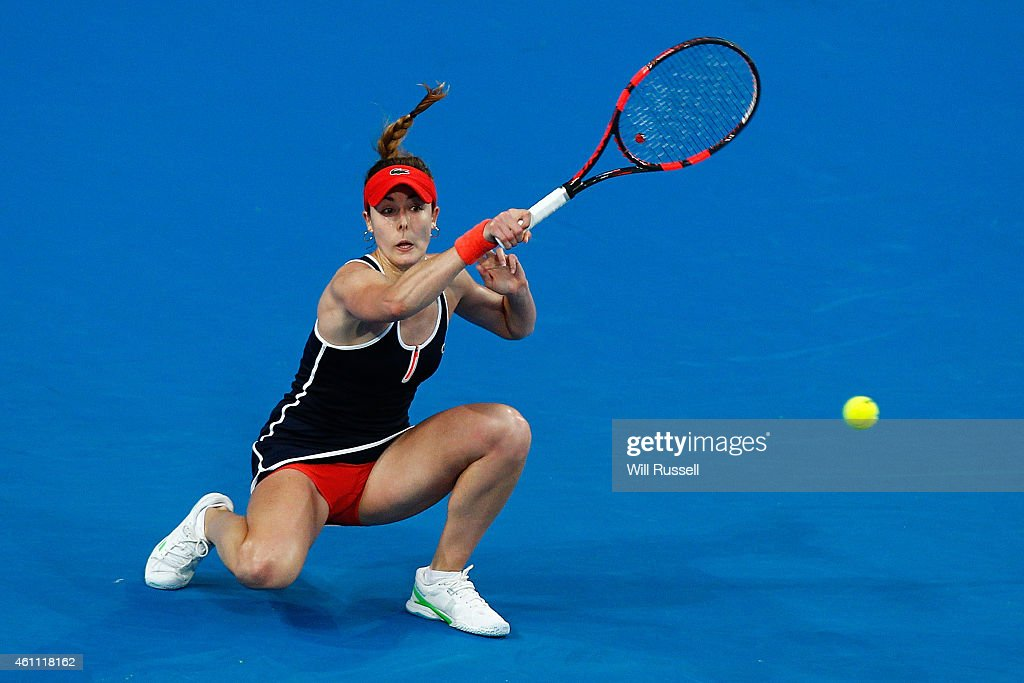 Alize Cornet of France plays a forehand to Casey Dellacqua of Australia in the women's singles match during day four of the 2015 Hopman Cup at Perth Arena on January 7, 2015 in Perth, Australia.