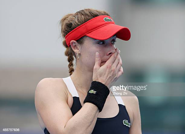 Alize Cornet of France reacts after losing the final match against Monica Niculescu of Romania on day six of the 2014 WTA Guangzhou Open at Tianhe...