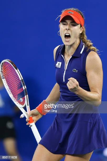 Alize Cornet of France reacts after winning a point during the ladies singles semi final match against Maria Sakkari of Greece on Day 5 of 2017...