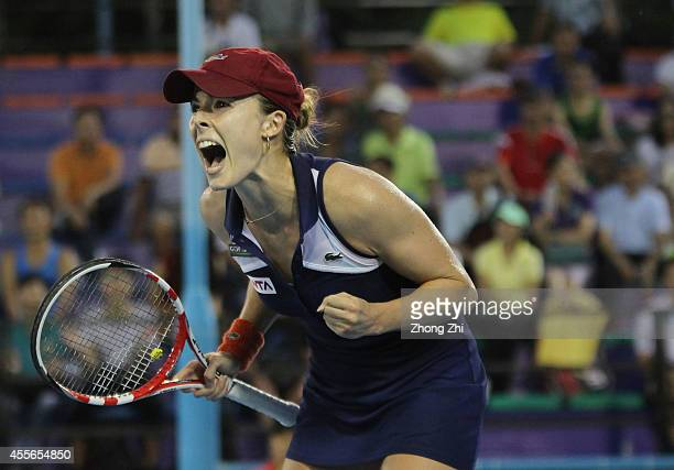 Alize Cornet of France reacts after winning her match against Hsieh Suwei of Chinese Taipei during day four of the 2014 WTA Guangzhou Open at Tianhe...