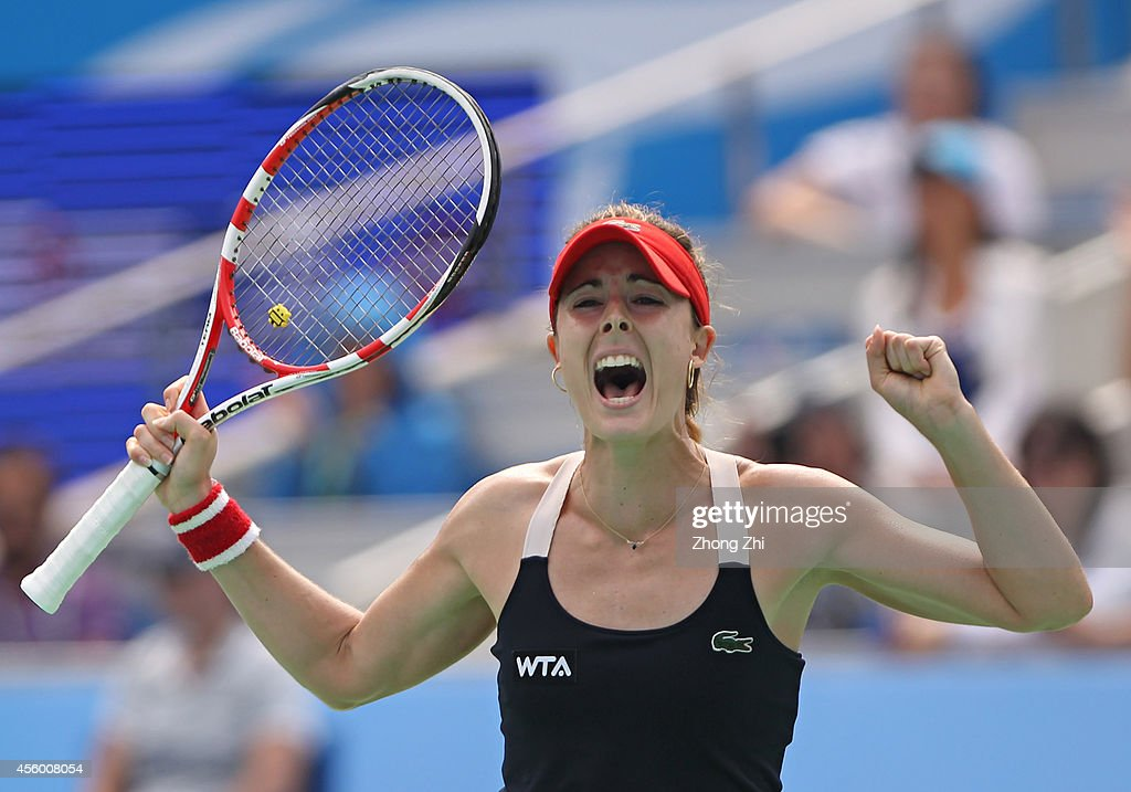 Alize Cornet of France reacts after winning her match against Kirsten Flipkens of Belgium on day four of 2014 Dongfeng Motor Wuhan Open at Optics Valley International Tennis Center on September 24, 2014 in Wuhan, China.
