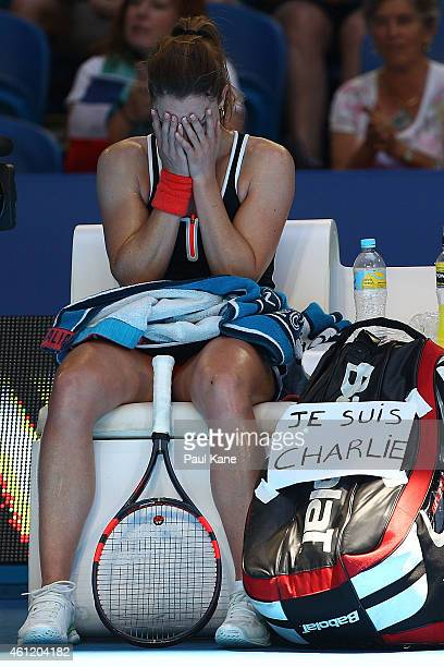 Alize Cornet of France reacts after winning her singles match against Agnieszka Radwanska of Poland during day six of the 2015 Hopman Cup at Perth...
