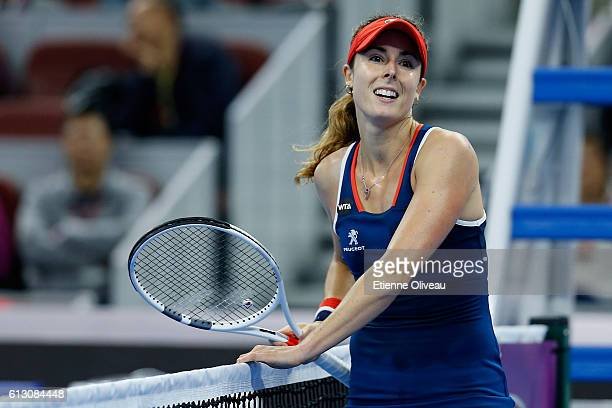 Alize Cornet of France reacts against Yaroslava Shvedova of Kazakhstan during the Women's singles third round match on day seven of the 2016 China...