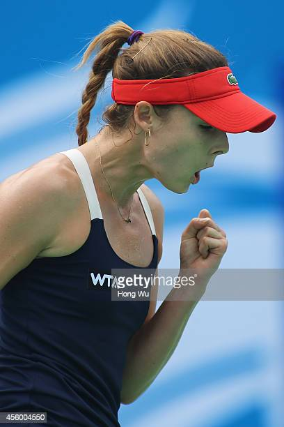 Alize Cornet of France reacts during her match against Kirsten Flipkens of Belgium during day four of the 2014 Dongfeng Motor Wuhan Open at Wuhan...
