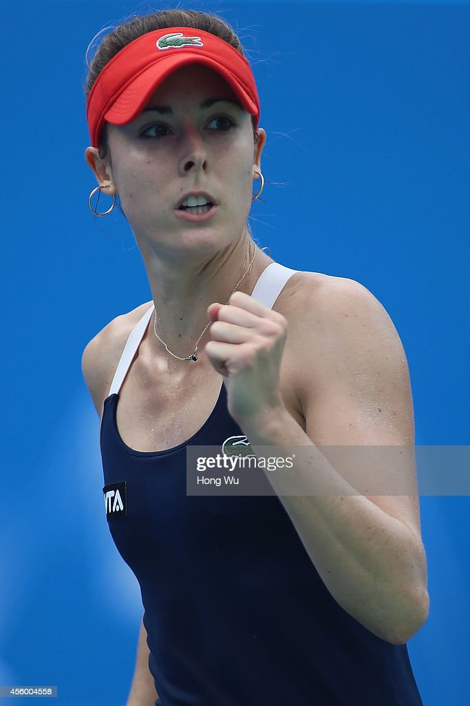 Alize Cornet of France reacts during her match against Kirsten Flipkens of Belgium during day four of the 2014 Dongfeng Motor Wuhan Open at Wuhan Optics Valley International Tennis Center on September 24, 2014 in Wuhan, China.