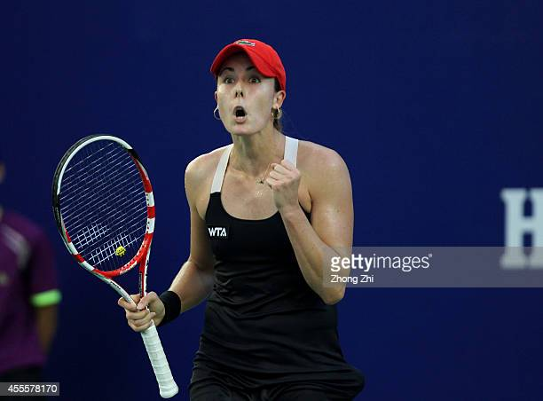 Alize Cornet of France reacts during her match against Shahar Peer of Israel during day three of the 2014 WTA Guangzhou Open at Tianhe Sports Center...