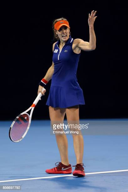 Alize Cornet of France reacts during the match against Angelique Kerber of Germany on day three of the 2017 China Open at the China National Tennis...