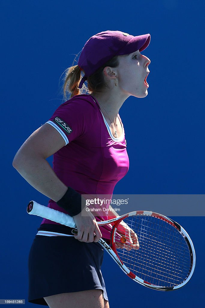 Alize Cornet of France reacts in her first round match against Marina Erakovic of New Zealand during day one of the 2013 Australian Open at Melbourne Park on January 14, 2013 in Melbourne, Australia.