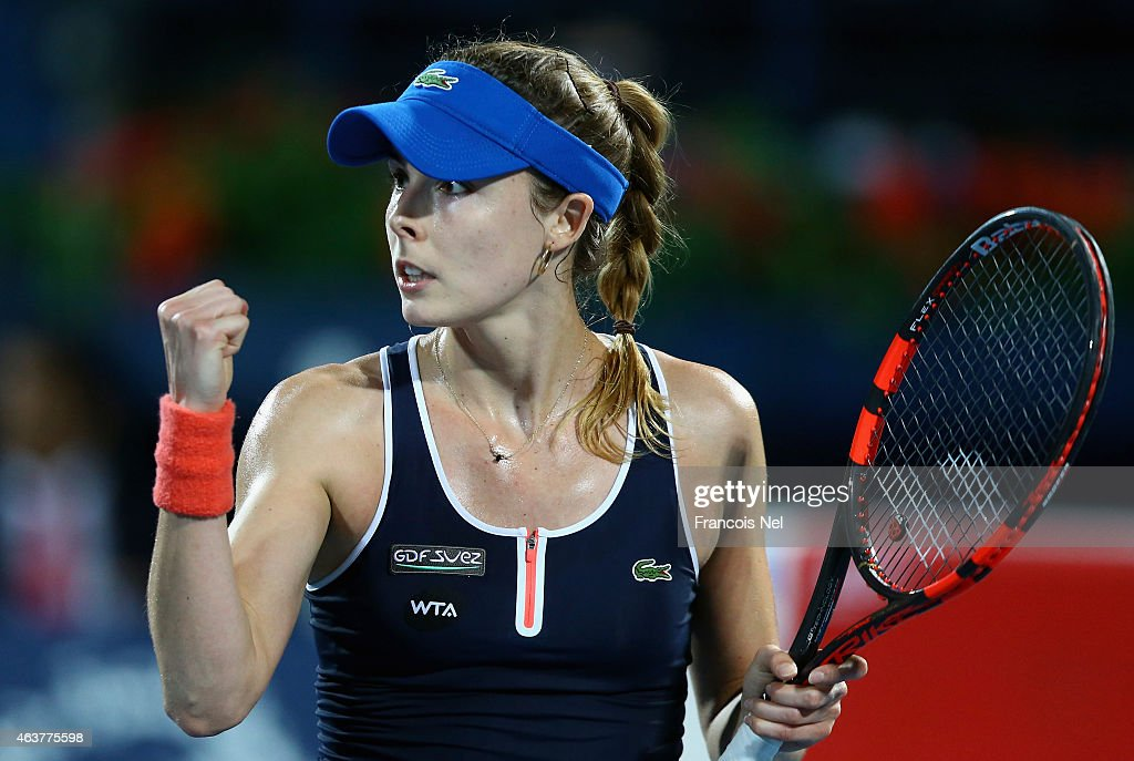 Alize Cornet of France reacts to a point in her match against Caroline Wozniacki of Denmark during day four of the WTA Dubai Duty Free Tennis Championship at the Dubai Duty Free Stadium on February 18, 2015 in Dubai, United Arab Emirates.