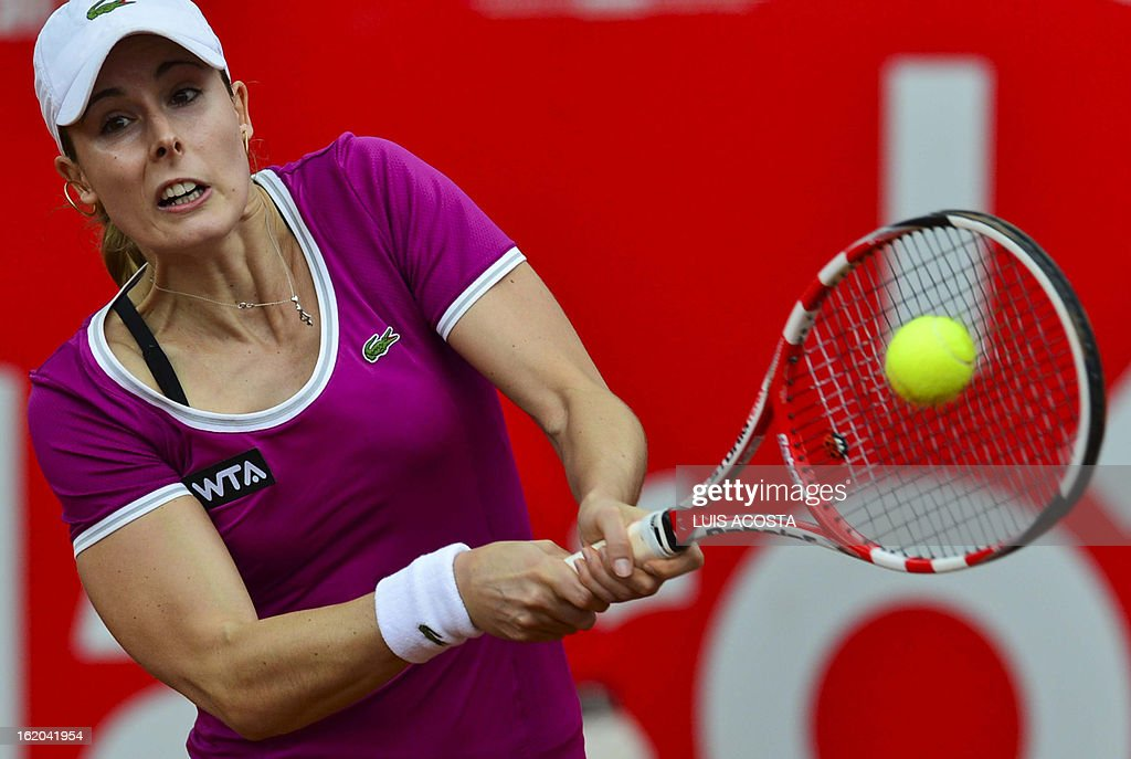 Alize Cornet of France return the ball to Elina Svitolina of Ukraine, during the WTA Bogota Open tennis Championship, on February 18, 2013. AFP PHOTO/Luis Acosta
