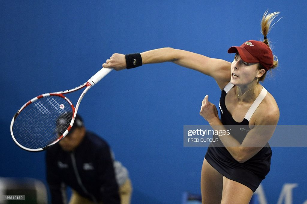 Alize Cornet of France returns a point against Samantha Stosur of Australia during their women's singles third round match at the China Open tennis tournament in the National Tennis Center of Beijing on October 2, 2014. Samantha won 6-4, 6-2.