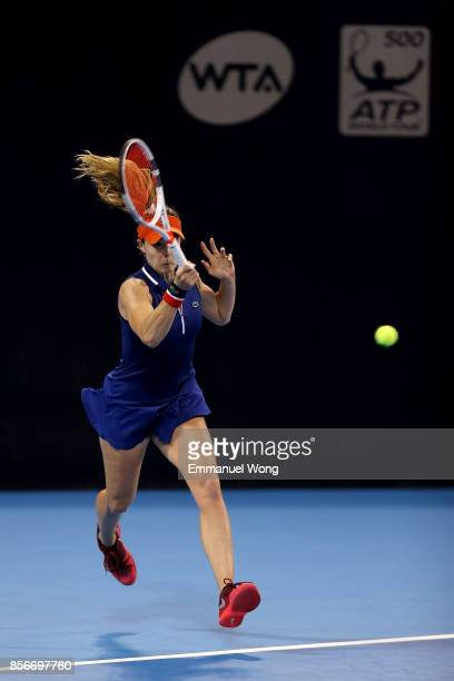 Alize Cornet of France returns a shot against Angelique Kerber of Germany on day three of the 2017 China Open at the China National Tennis Centre on...
