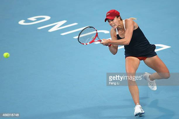 Alize Cornet of France returns a shot against Jelena Jankovic of Serbia during day three of the China Open at the China National Tennis Center on...