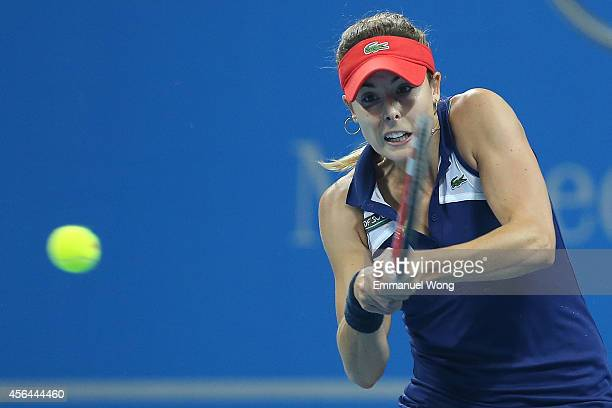 Alize Cornet of France returns a shot against Lauren Davis of the United States of America during day five of the China Open at the China National...