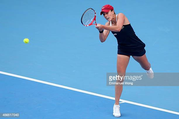 Alize Cornet of France returns a shot against Samantha Stosur of Australia during day six of the China Open at the China National Tennis Center on...